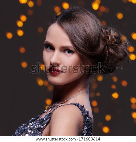 Woman with beautiful hairstyle at new year party celebration