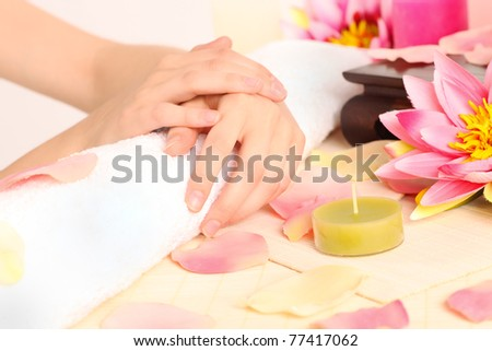 Woman with beautiful hands after a manicure