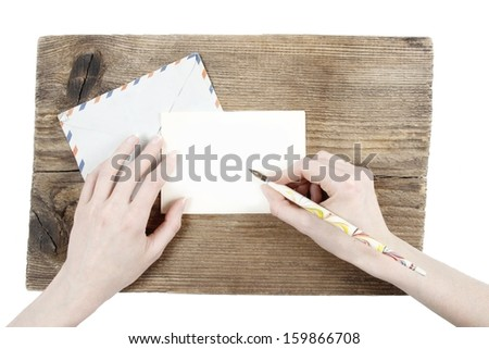 Woman with beautiful hands writing a letter. Graphic element - stock photo