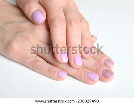 Woman with beautiful purple nails - stock photo