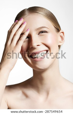 Woman with beautiful skin and smile Close-up on a white background - stock photo