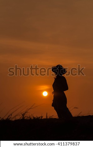 Woman with beautiful sunset light.