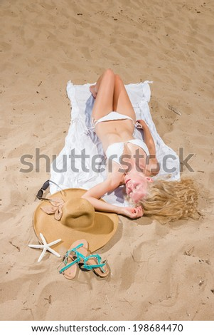 woman with beautiful white sarong on tropical beach - stock photo