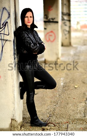 Woman with beauty long black hair. Outdoor portrait.