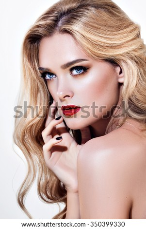Woman with beauty long blond hair and red lips- posing at studio. Isolated on white - stock photo