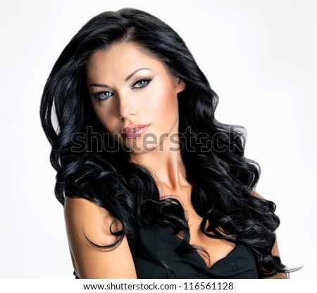 Woman with beauty long brown hair - posing at studio - stock photo