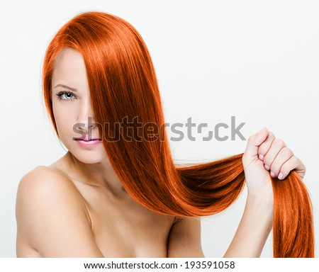Woman with beauty long red hair - stock photo
