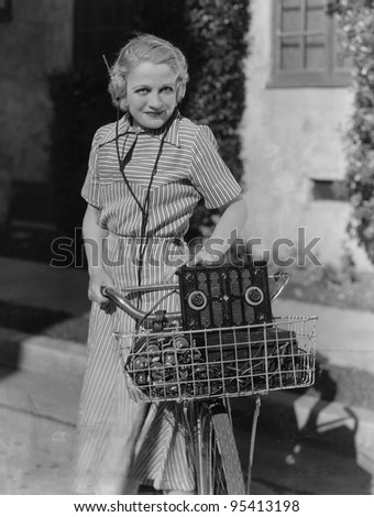 Woman with bicycle and radio - stock photo