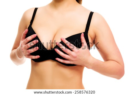 Woman with big breasts, white background, isolated, copyspace - stock photo