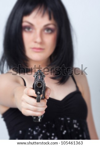 Woman with big gun in hand