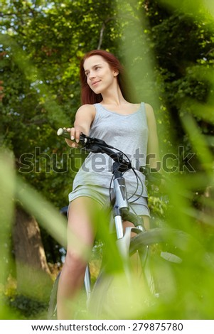 woman with bike - stock photo