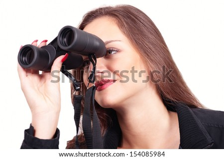 Woman with binoculars looking with interest - stock photo