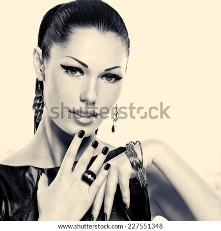 Woman with black nails and with stylish bijouterie. Black or white image concept - stock photo