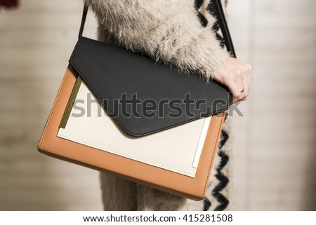 Woman with black,white and beige fashion bag