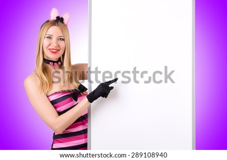 Woman with blank board against the gradient - stock photo