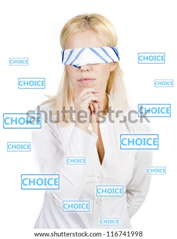 Woman with blindfold trying to make a choice - stock photo