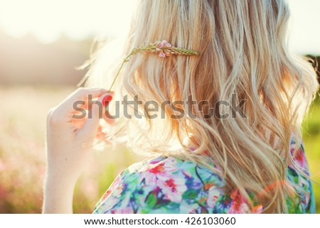 woman with blonde hair at sunlight - stock photo