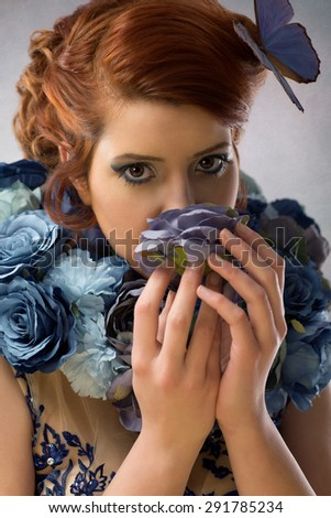 Woman with blue and purple flowers - stock photo