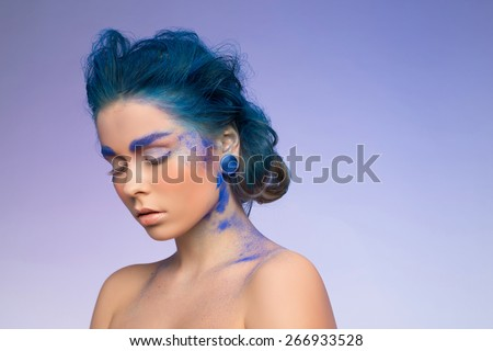 woman with blue visage. blue hair. - stock photo