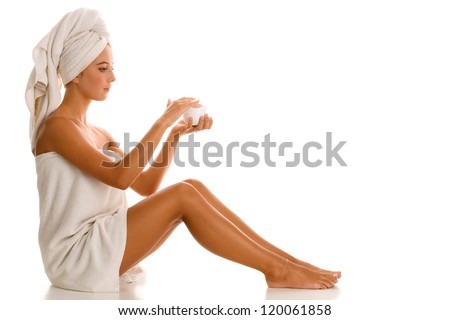 Woman with body lotion - stock photo
