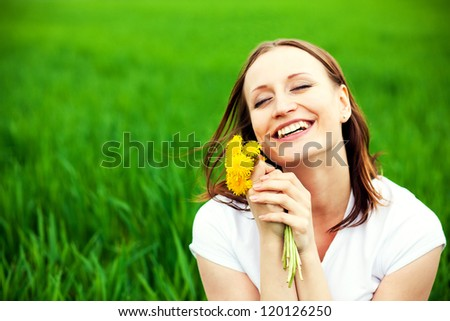 woman with bouquet dandelions outdoors - stock photo