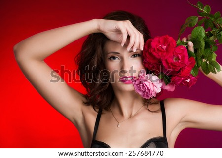 Woman with bouquet of red and pink roses. - stock photo