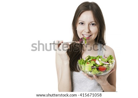 Woman with bowl of salad, isolated on white.