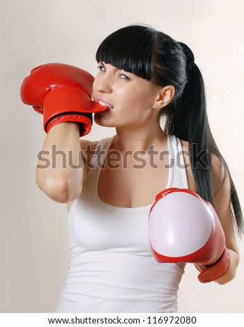 Woman with boxing gloves - stock photo