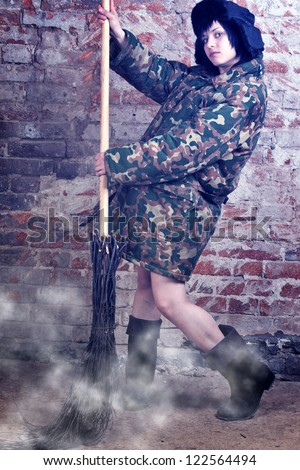 Woman with broom - stock photo