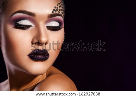 woman with brown eyes in studio on black background