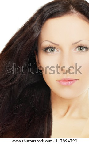 Woman with brown hair, beauty salon background - stock photo