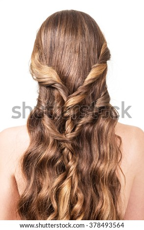 Woman with brown, long, wavy, twisted hair isolated on white background