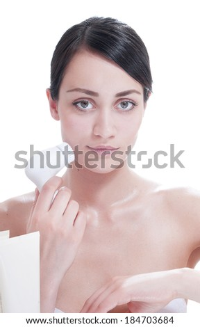 Woman with brush for deep cleansing facial. Skin care concept. High technology beauty.  - stock photo