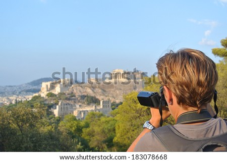 Woman with camcorder takes a picture at Acropolis in Athen (Greece) - stock photo