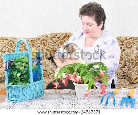 woman with cat near flower - stock photo