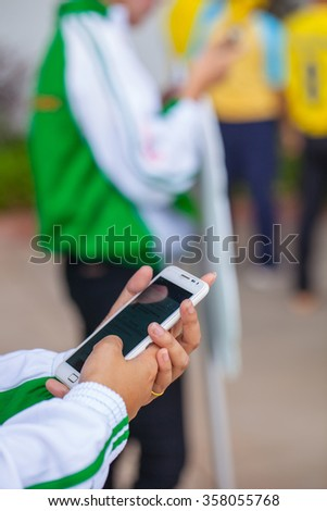 Woman with cell phone in hand modern touch on the screen. - stock photo