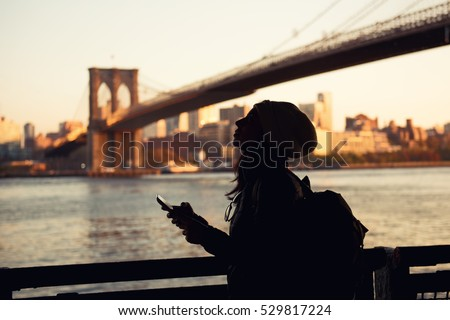 woman with cellular phone in new york city