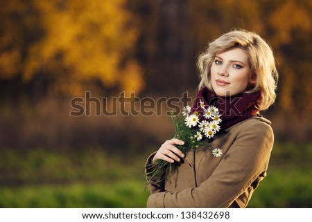 Woman with chamomile bouquet - stock photo