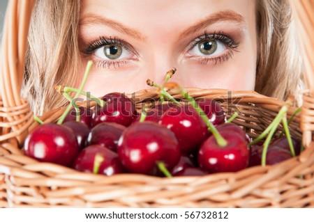Woman with cherries - stock photo