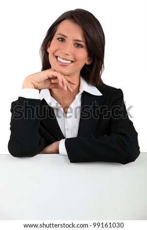 Woman with chin on hand - stock photo
