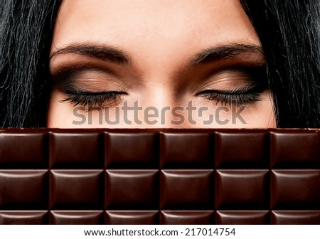 Woman with chocolate - stock photo