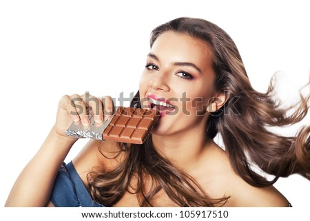 woman with chocolate in hand on white background - stock photo