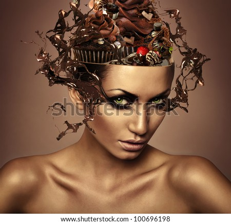 woman with chocolate in head and splash on eyes - stock photo