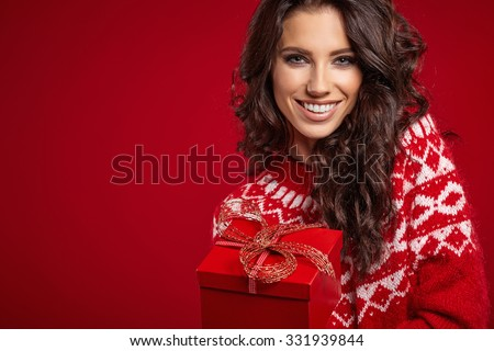 Woman with christmas box gift - stock photo