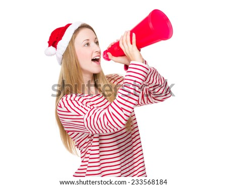 Woman with christmas hat and shout with megaphone - stock photo