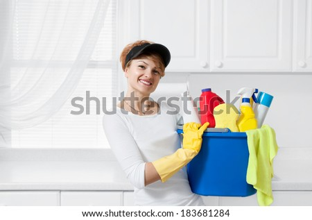 Woman with cleaning products  - stock photo