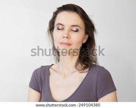 Woman with closed eyes - stock photo