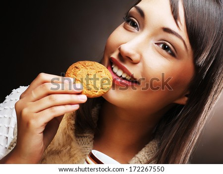 woman with coffee and cookies - stock photo