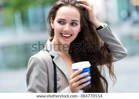 Woman with coffee to go - stock photo