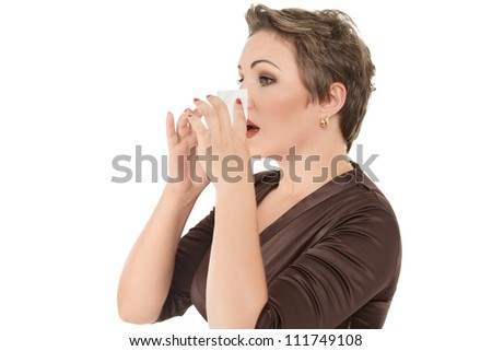 Woman with cold or flu sneezing into tissue over white background - stock photo